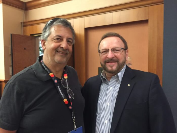 The author Ray Hanania (left) with Wayne Messmer, the popular sports figure who sings the National Anthem (right). Photo courtesy Ray Hanania. Permission granted to republish with full attribution