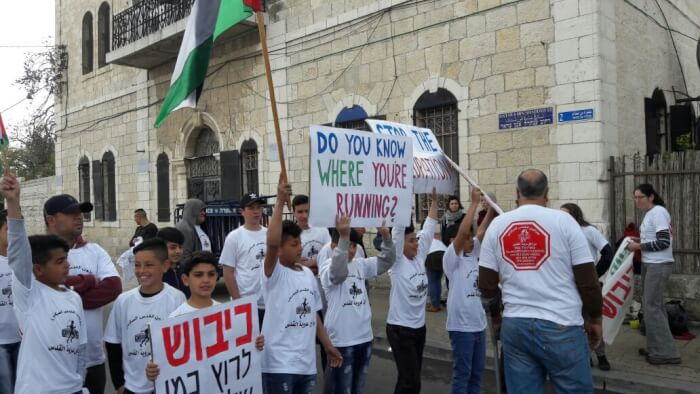 Palestinians and Israelis protest the annual Jerusalem Marathon. Photo courtesy of the protestors.