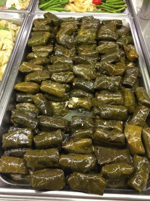 Greek Dolmades, stuffed grape leaves served cold, drenched in olive oil and without any meat, are commonly offered in many Mediterranean themed deli sections in mainstream grocery stores. Photo courtesy of Ray Hanania