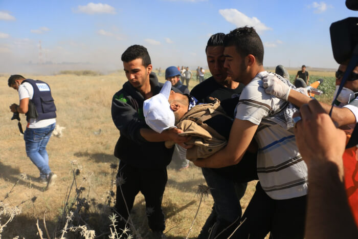 Palestinians injured while protesting in support of hunger strikers at the Gaza border with Nahal Oz. Photo copyright Gaza Strip Photographer Ahmad Hasaballah