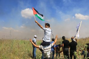 Palestinians protest in support of hunger strikers at the Gaza border with Nahal Oz.  Photo copyright Gaza Strip Photographer Ahmad Hasaballah