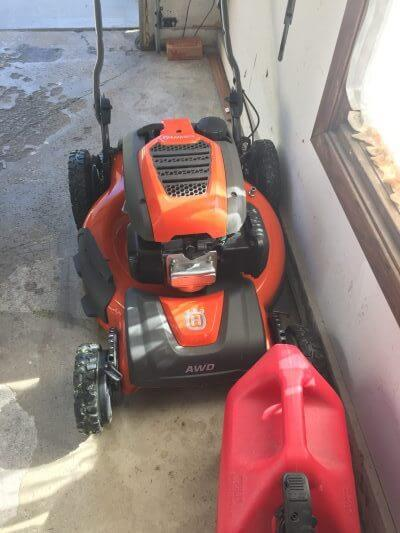 Lawn mower and gas can