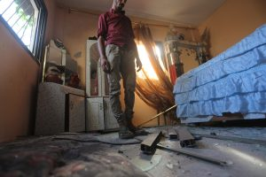 A Palestinian inspects damage to his home caused by Israeli air and missile fire Monday June 26, 2017. Photo courtesy of Mohammed Asad. All Rights Reserved