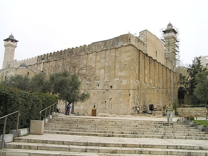 Hebron and the Israeli settler and military threatened Ibrahimi Mosque where three prophets of the Bible important to Christians and Muslims are buried, Abraham, Issac and Jacob, and their wives. Israel has divided the city, destroyed the business commercial center and brutalized non-Jews to protect 800 fanatic religious Jewish haters. (Photo credit: Wikipedia)