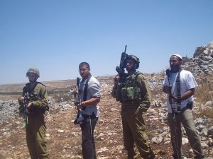 IDF soldiers and Israeli settlers (Photo credit: Wikipedia)