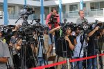 News media, reporters, microphones, Journalists at the UN School in Beit Lahi, Gaza Strip wait for the press briefing by António Guterres, the ninth Secretary-General of the United Nations. Guterres visited Palestine August 29 and 30, 2017. Photo courtesy of Mohammed Asad.