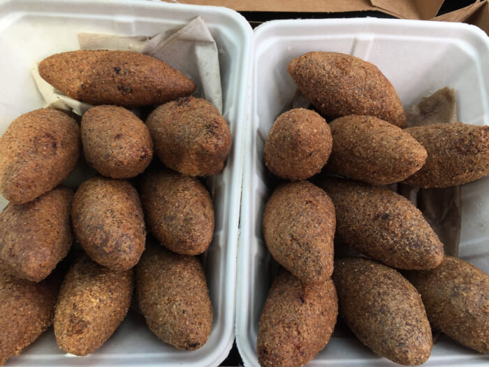 Fried Kubbah, Kibbeh made from burghul stuffed with lamb and browned sliced almonds or browned pine nuts. Photo courtesy of Ray Hanania