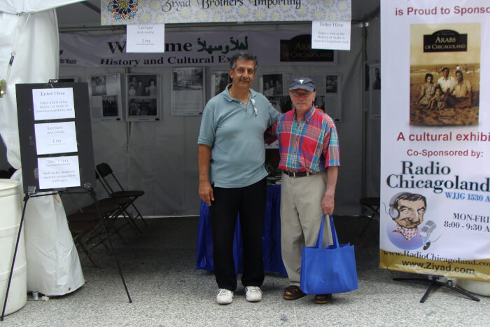 Author Ray Hanania with visitors in front of the display at the Arabesque Festival in June 2010 when Richard M. Daley was mayor and before Mayor Rahm Emanuel racistly blocked involvement of Arabs in Chicago life. Photos by Ray Hanania