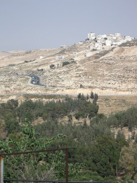 Partial view of the hilltop Palestinian village of Hisma (Hizma), with northbound Jerusalem highway and Mir Forest in the foreground. (Photo credit: Wikipedia)