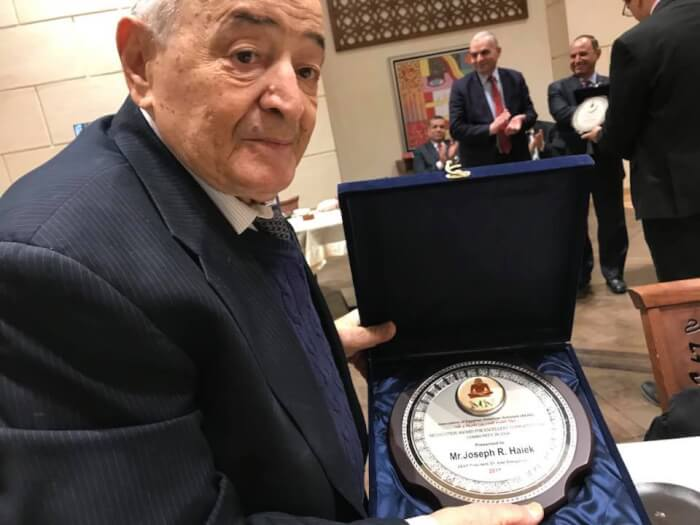 Joseph R. Haiek displays the award he received from the Association of Egyptian American Scholars (AEAS) on Dec. 27 during their 44th Annual Conference.