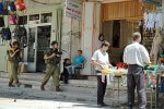 Open-air market in city being patrolled by Israeli troops (2004). (Photo credit: Wikipedia)