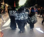Women in Berqas protesting about ISO at a recent rally in France. Photo courtesy of Abdennour Toumi