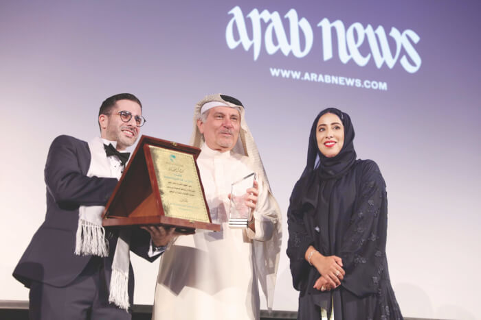 Arab News Editor & Chief Faisal J. Abbas (left) joins Dubai Press Club Director Mona Ghanem Al Marri (right) honors former Arab News Editor Khaled al-Maeena for his years of journalism at the 2018 Arab Media Forum in Dubai. Photo courtesy of the Arab News