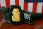 FBI Badge & gun. (Photo credit: Wikipedia)