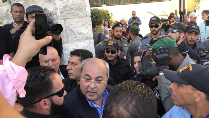 Israeli Knesset Deputy Speaker Ahmad Tibi is beaten by Israeli police while participating in a protest against the relocation of the US Embassy Monday May 14, 2018. Photo courtesy of MK Ahmad Tibi
