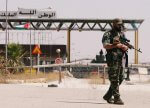 A Syrian soldier at the Nasib border crossing with Jordan in Deraa, Syria on July 7, 2018. At least 70 journalists and media workers are caught in Quneitra between advancing forces aligned with Syrian President Bashar al-Assad and the closed borders of Israel and Jordan, according to CPJ research. (Reuters/ Omar Sanadiki) Photo courtesy of the Committee to Protect Journalists