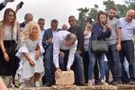 Michigan Accident Attorney Joumana Kayrouz helps place the corner stone for the new Youth Hub Center she is funding in Batroun, Lebanon with Gebran Bassil, Minister of Foreign Affairs and Emigrants. Photo courtesy of Joumana Kayrouz