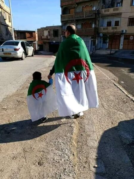 Father and son attend rally in Algeria against Bouteflika. Photo courtesy of Abdennour Toumi