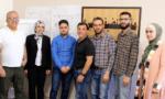 Left to right: Amjad Tadros, Noura Hourani, Walid Noufal, John DeBlasio, Ammar Hamou, Mohammad Ibrahim, and Alaa Nassar.