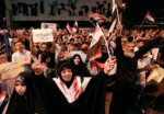 Iraqi protesters chant slogans during a demonstration in Tahrir Square in central Baghdad, Iraq, on June 21, 2019. Iraq suspended U.S.-funded broadcaster Al-Hurrah for 3 months over a corruption report on September 2. (AP Photo/Hadi Mizban) Photo courtesy of the Committee to Protect Journalists.