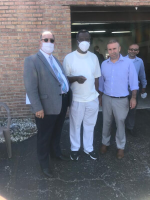 Photo caption: American Arab Chamber President Hassan Nijem, Dr. Willie Wilson, and Palestine Club President Mazen Dola pause during the distribution of the masks.