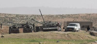 Military forces train near Khirbet Jenbah, bordering Masafer Yatta, 2 Feb. 2021. Photo credit: Naser Nawaj'ah, B'Tselem